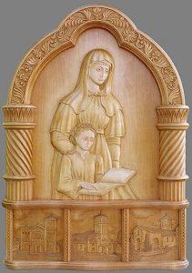 bas relief en bois vernis marron claire de la paroisse ste anne de lizeron repésenatnt Anne et sa fille Marie mère de Jésus